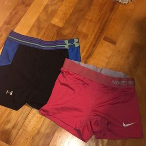 2 Nike and Under Armour compression shorts